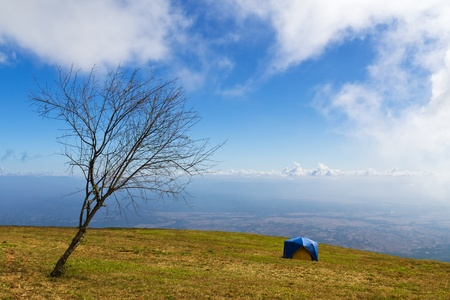 Tent on a grass under white clouds and blue sky Stock Photo - 11552856