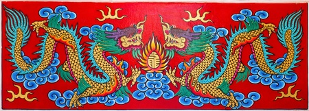 red dragon: Art Chinese style painting two dragon on wall in temple.Thailand.Generality in Thailand, any kind of art decorated in Buddhist church etc. created with money donated by people, no restrict in copy or use.