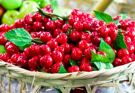 Fake red Cheries on basket in the market photo