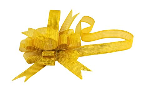 Golden gift bow. Ribbon on white background photo