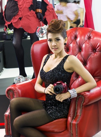NONTHABURI,THAILAND-DECEMBER 3: Female presenters model at the Canon booth during Bangkok International Motor Show at Impact Challenger on December 3, 2011 in Nonthaburi, Thailand.
