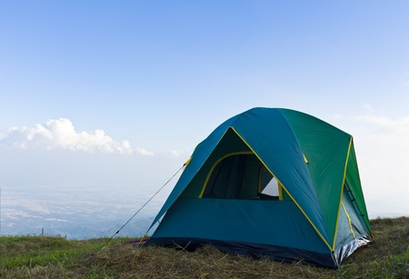 Tent on a grass under white clouds and blue sky Reklamní fotografie