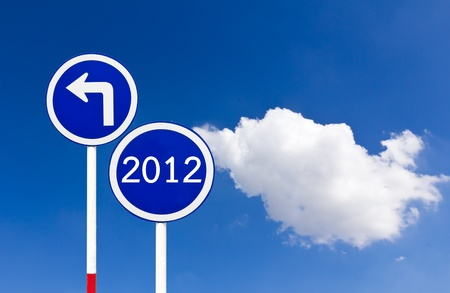 Curved Road Traffic Sign 2012 over blue sky,turn left photo