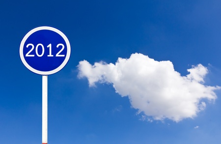 Round sign 2012 New Year concept on blue sky photo