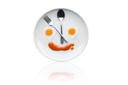 Time for lunch ,Fried egg heart of the clock on the dinner plates.