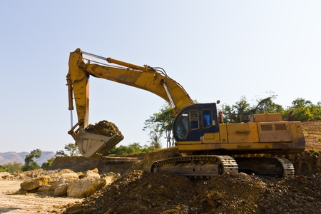 Excavator loader machine during earthmoving works in mine Stock Photo - 12529824