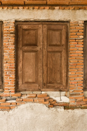Old wooden window on old brick wall Stock Photo - 12529812