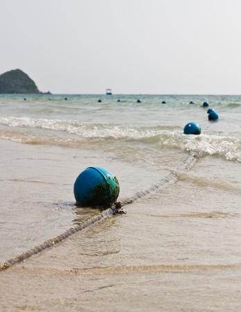 beach buoy: Blue buoy on the beach Stock Photo