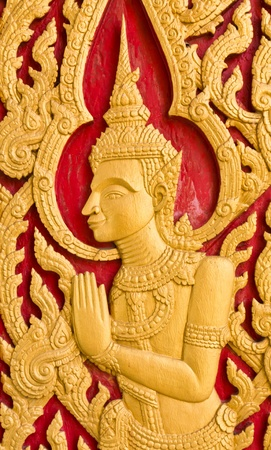 Traditional Thai art church door in temple,Thailand photo