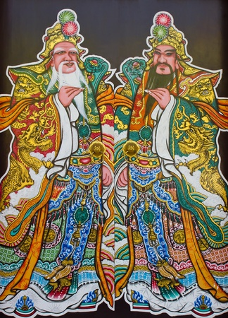 Tradition Chinese painting two emperor on Chinese temple wall at Saraburi province Thailand photo
