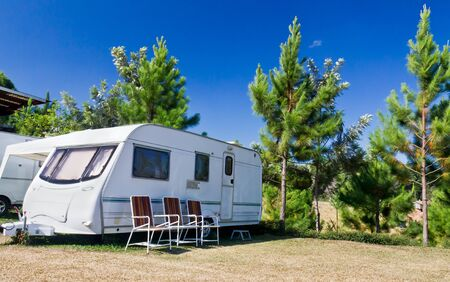 Caravans  camping in the park with background mountains photo