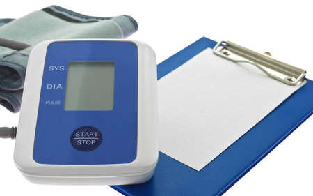 Blood pressure and blank medical clipboard photo