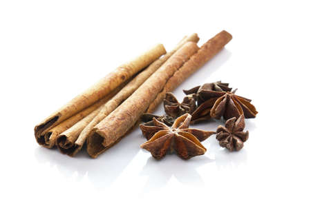 Cinnamon  and anise  on white background photo
