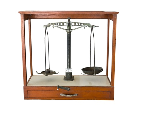 antique weight scale: Old scales in wood cabinet on a white background