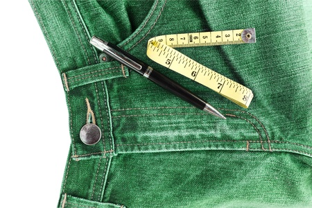 Pen and measuring tape on jeans photo