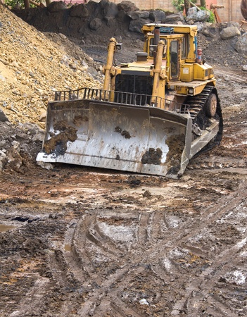 Bulldozer machine doing earthmoving work in mining photo