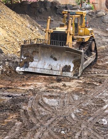heavy machinery: Bulldozer machine doing earthmoving work in mining