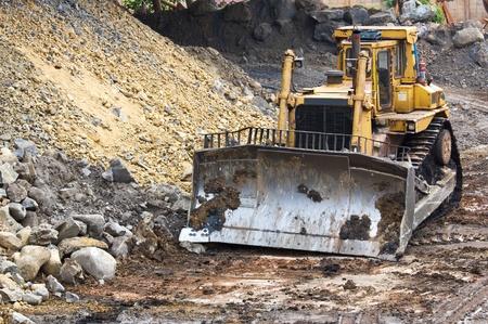 Bulldozer machine doing earthmoving work in mining