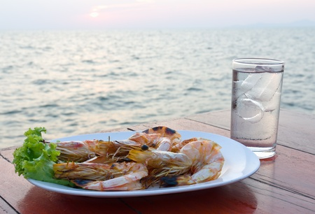 Grilled shrimp at a seaside restaurant in Thailand photo