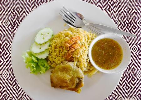 Plate of delicious chicken biryani Thai style photo
