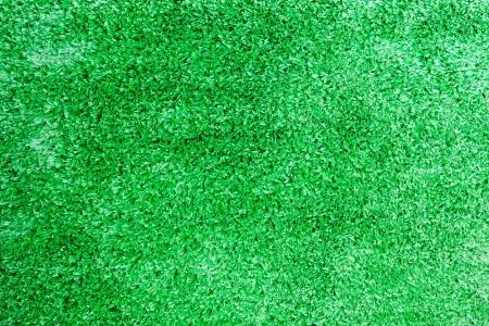 Artificial green grass field top view texture photo