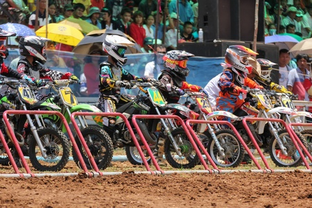 supercross: MUAKLEK, THAILAND - AUGUST 05  Unidentified riders participate in  competition Supercross Championship of Thailand, on August 05, 2012 in Muaklek, Saraburi,Thailand Editorial