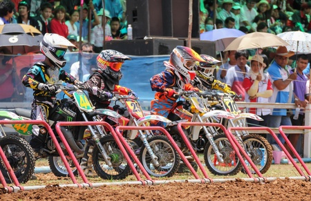 panning shot: MUAKLEK, THAILAND - AUGUST 05: Unidentified riders participate in  competition Supercross Championship of Thailand, on August 05, 2012 in Muaklek, Saraburi,Thailand Editorial