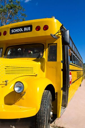 Front of Yellow School Bus with Blue Sky photo