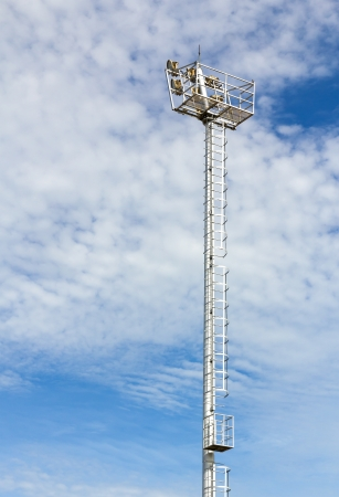 The Stadium Spot-light tower over Blue Sky Stock Photo - 15381068
