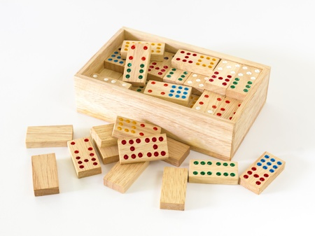 Wooden Domino in wooden box against the white background photo