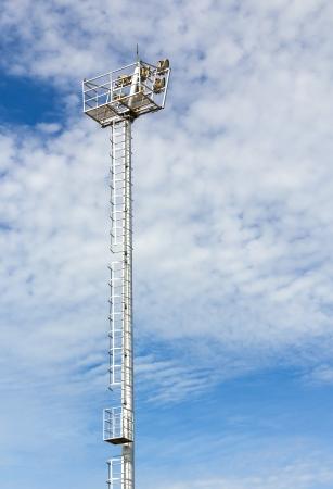 The Stadium Spot-light tower over Blue Sky Stock Photo - 15718992