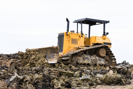Bulldozer machine doing earth moving work in construction site Stock Photo - 16027250