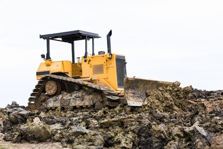 Bulldozer machine doing earth moving work in construction site Stock Photo - 16231856