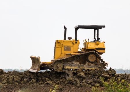 Bulldozer machine doing earth moving work in construction site Stock Photo - 16363936