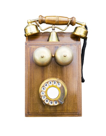 Antique wooden telephone isolated on white background photo