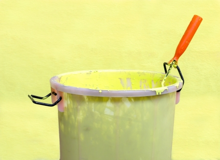 paintroller: Paint-roller and Paint bucket with paint on a green background
