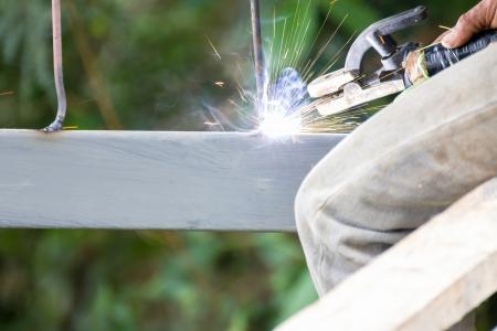 Welder welding  elements at the  construction site