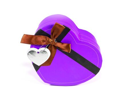 Violet Heart-shaped box in heart shape on white background photo