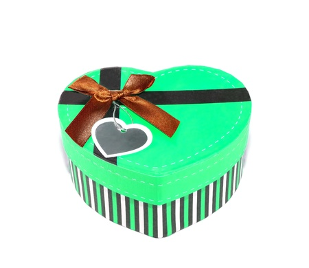 Green Heart-shaped box in heart shape on white background photo