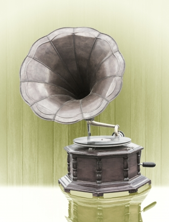 Vintage Gramophone with disc isolated on grunge background photo