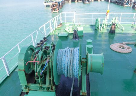 Winch with rope on ferry dropping anchor forward mooring station photo