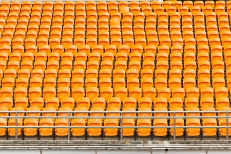Rows of empty seat in stedium at National stedium Thailand  photo