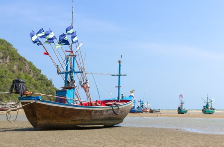 Fishing boat on the beach  Hua Hin Beach, Thailand photo