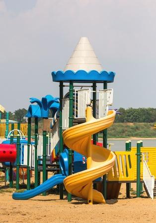 Modern children playground in park without children photo