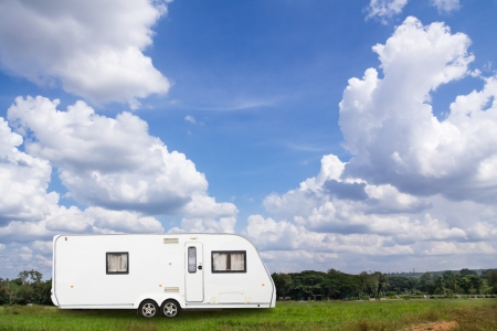 Caravans camping in the park with blue sky photo