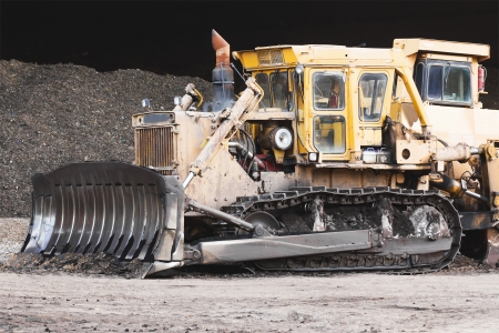 earth moving: Bulldozer machine doing earth moving work in construction site