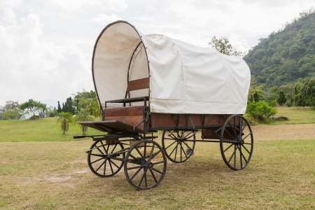 horse carriage: Covered wagon with white top in park Stock Photo