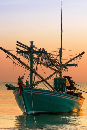 Fishing Boat on sunset  a background of  beautiful sunset photo