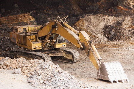 earth moving: Excavator doing earth moving work in mining site