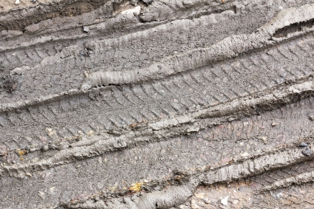 tire tracks: Wheel track in countryside road. Tire tracks in the mud